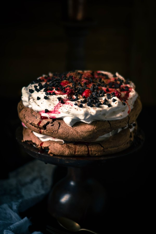 Chocolate Pavlova with Raspberry compote and cream