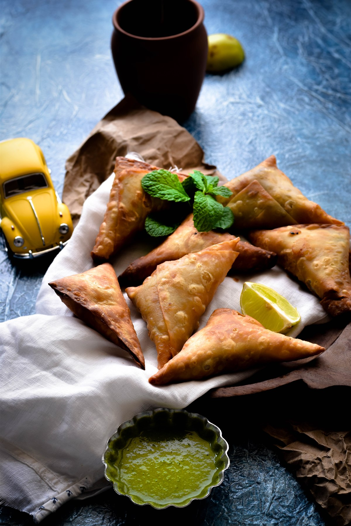 Achari Murg Samosa – Samosa stuffed with chicken cooked in pickling spices